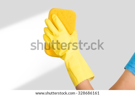 woman hand in yellow glove with sponge on white background