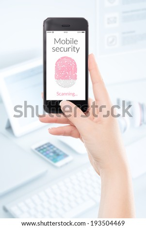 Woman hand is scanning fingerprint by modern black smartphone. Mobile security concept. - stock photo
