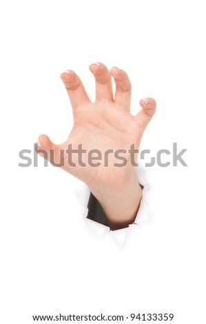 Woman hand making sign through a hole in paper isolated on white background