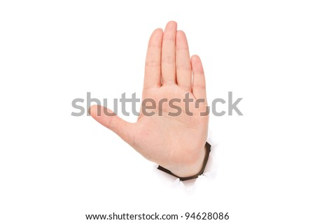 Woman hand making sign through a hole in paper isolated on white background - stock photo