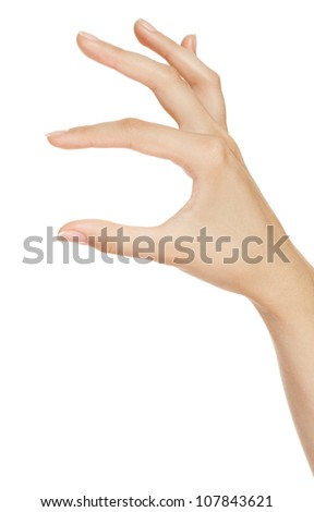 woman hand measuring invisible items. Isolated on white. - stock photo