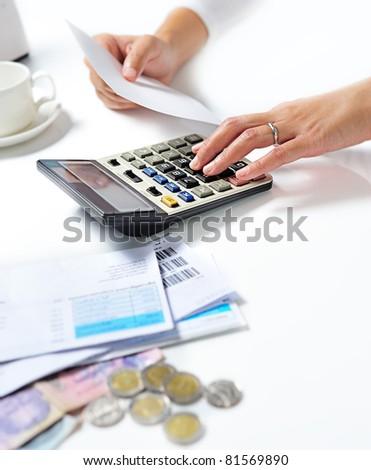 Woman hand on calculator - stock photo