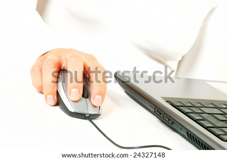 Woman hand on computer mouse - stock photo