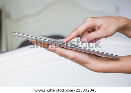 Woman hand on tablet pc, access for knowlwdge
