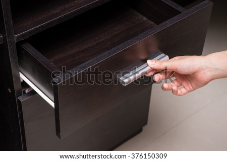 Woman hand open drawer