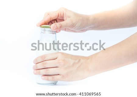 Woman hand open traditional glass milk bottle, stock photo