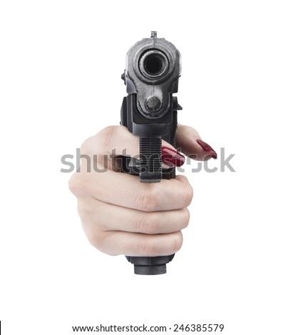 woman hand pointing gun - stock photo