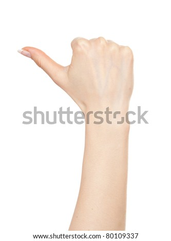 Woman hand pointing left with a thumb