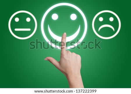 woman hand pointing to a positive feedback button on green background