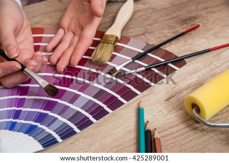 woman hand pointing to color samples - stock photo