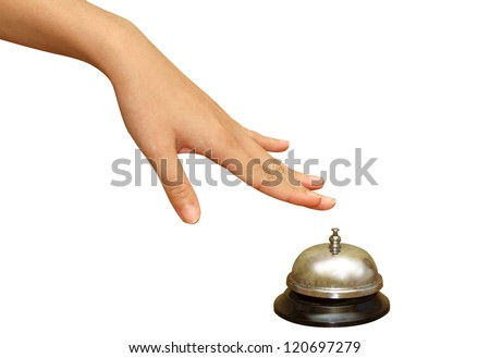 woman hand pressing  a hotel service bell in  isolated background,Hand of a businessperson using a hotel bell - stock photo