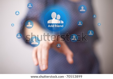 woman hand pressing add friend button - stock photo