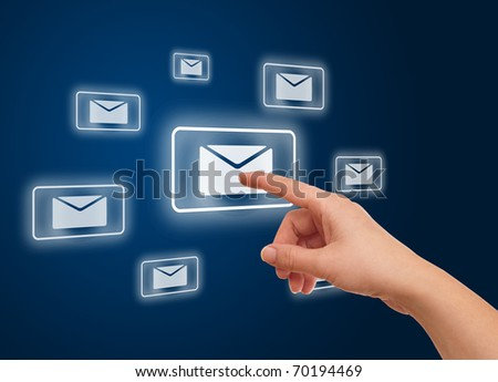 woman hand pressing e-mail icon - stock photo