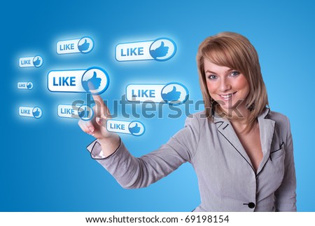 woman hand pressing LIKE button on blue background