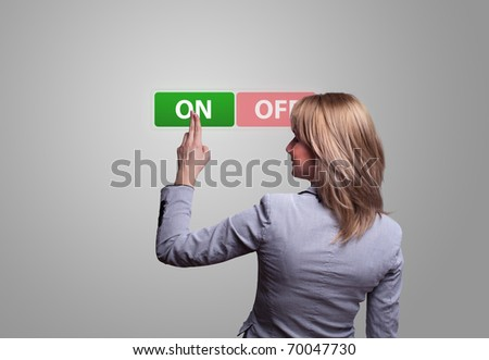 woman hand pressing ON button - stock photo