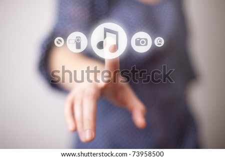 woman hand pressing Play button - stock photo