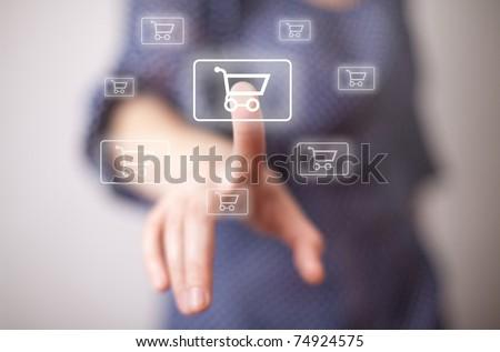 woman hand pressing shopping cart icon - stock photo