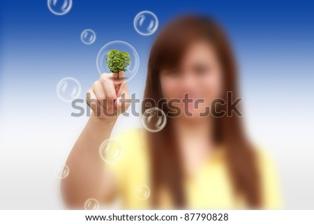 woman hand pressing tree bubble - stock photo