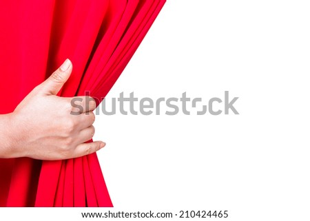 woman hand pulling red velvet luxury curtain place for text isolate on white background with clipping path - stock photo