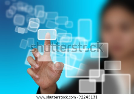 woman hand push on technology virtual touch screen interface (selective focus at finger) - stock photo