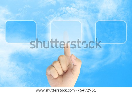 woman hand pushing a button on a touch screen interface in the blue sky - stock photo