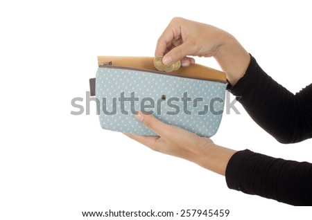 Woman hand put money in purse isolated on white background