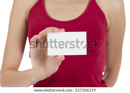 Woman hand showing a blank business card with the focus on card - stock photo