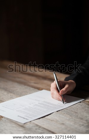 woman hand signing document