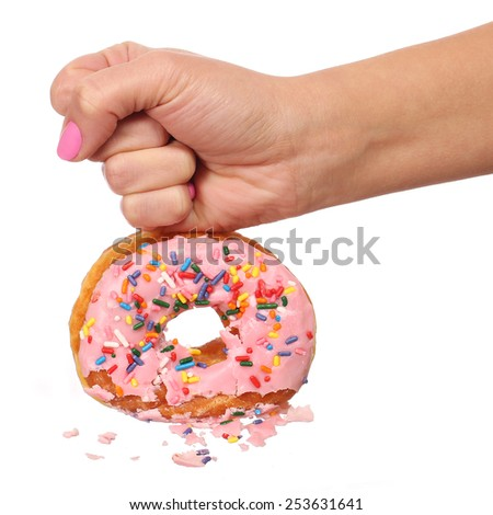 Woman Hand Smashing Donut with Sprinkles isolated on white background