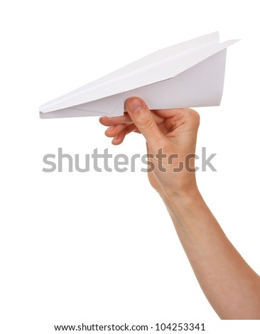 Woman hand throwing paper plane isolated on white background - stock photo