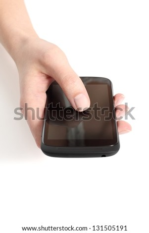 Woman hand touching a touch screen of a mobile phone with her thumb on a white isolated background - stock photo