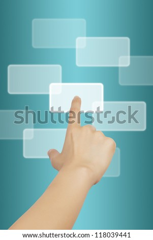 Woman hand touching button on blue background. - stock photo