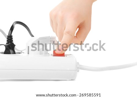 woman hand turn on switch on extension cord isolated on white - stock photo