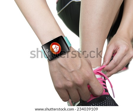 woman hand tying shoelaces wearing bright blue watchband touchscreen smartwatch with red health icon isolated on white background - stock photo