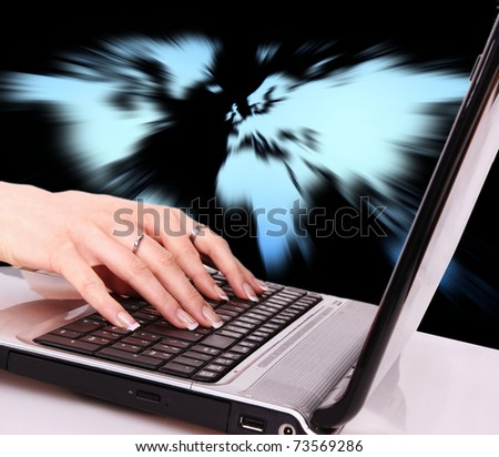 Woman hand typing on laptop - stock photo