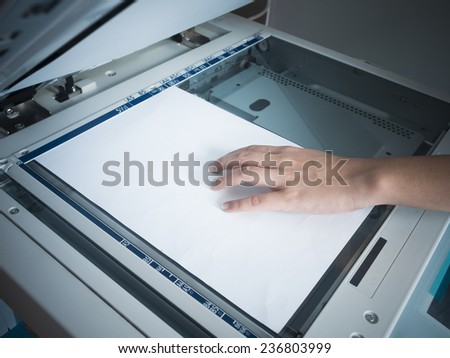 Woman hand using copy print machine - stock photo