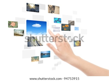 Woman hand using touch screen interface with pictures in frames. Isolated on white. - stock photo