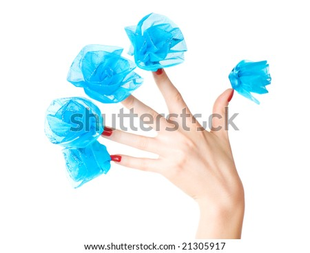 Woman hand with blue flowers on nails. Isolated on white.