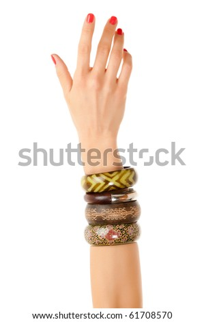 Woman hand with bracelets - stock photo