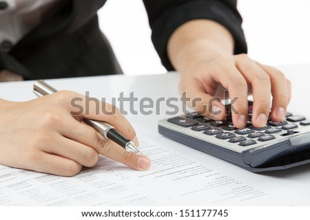 woman hand with calculator and business report