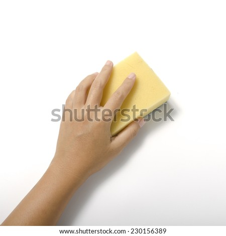 woman hand with cleaning sponge on a white background - stock photo