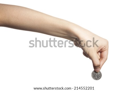 Woman hand with coin isolated on white - stock photo