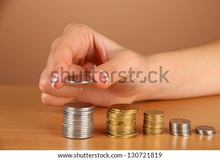 Woman hand with coins, close up