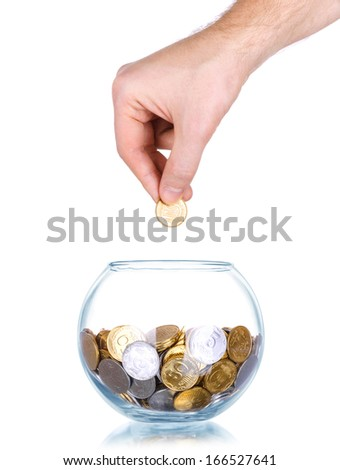 Woman hand with coins in glass jar, isolated on white background - stock photo