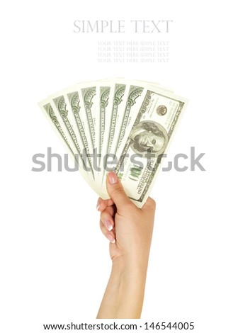 Woman hand with 100 dollar bills isolated on a white background