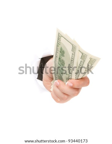 Woman hand with dollars through a hole in paper isolated on white background - stock photo