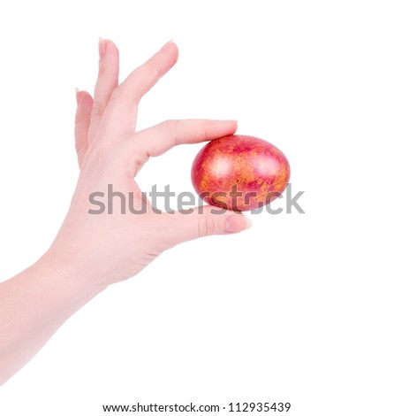 Woman hand with eggs isolated on white background - stock photo