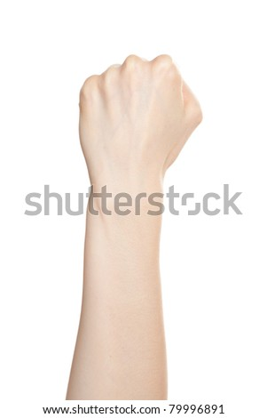 Woman hand with fingers folded into a fist pointing up - stock photo