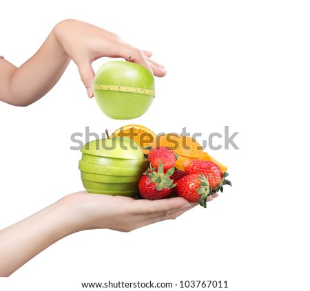 Woman hand with fruits isolated on a white background