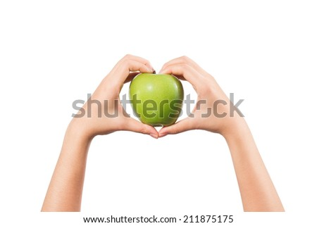 Woman hand with heart shape holding green apple isolated on white background.  - stock photo